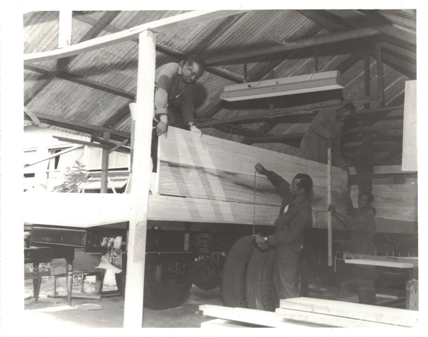 Carpenters construct the wooden body of a new truck. Source: GT-9A Photographic Section, Information Services Department, Ministry of Information, Accra, Ghana.