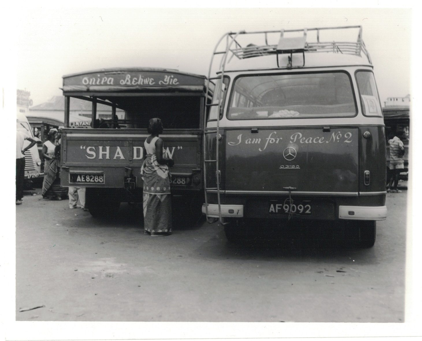"""Old and new mammy trucks"", Paul K. Anane, 22/4/60. Source: R/9720/6 Photographic Section, Information Services Department, Ministry of Information, Accra, Ghana."
