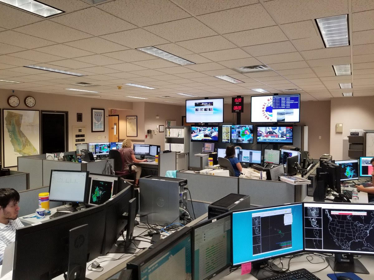 Computer screens dominate the workspace of the National Weather Service's San Francisco Bay Area office, August 2018. Source: National Weather Service San Francisco Bay Area office, via Twitter, https://twitter.com/nwsbayarea/status/1033018086625030145.