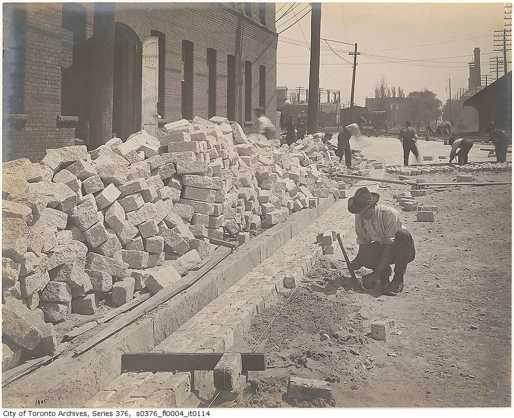 Workers installing granite Belgian block pavement on The Esplanade in Toronto, 1905. Source: City of Toronto Archives, Fonds 200, Series 376, File 4, Item 114.