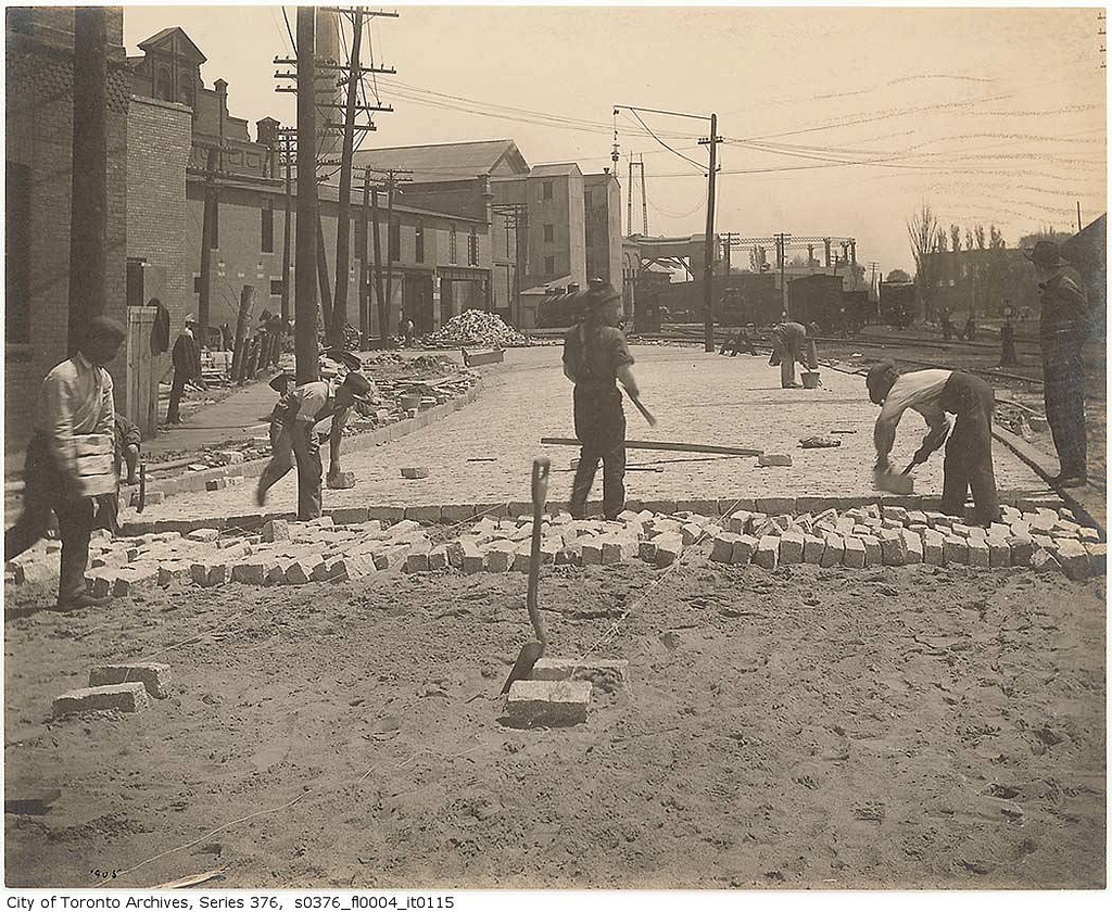Workers installing granite Belgian block pavement on The Esplanade in Toronto, 1905. Source: City of Toronto Archives, Fonds 200, Series 376, File 4, Item 115.