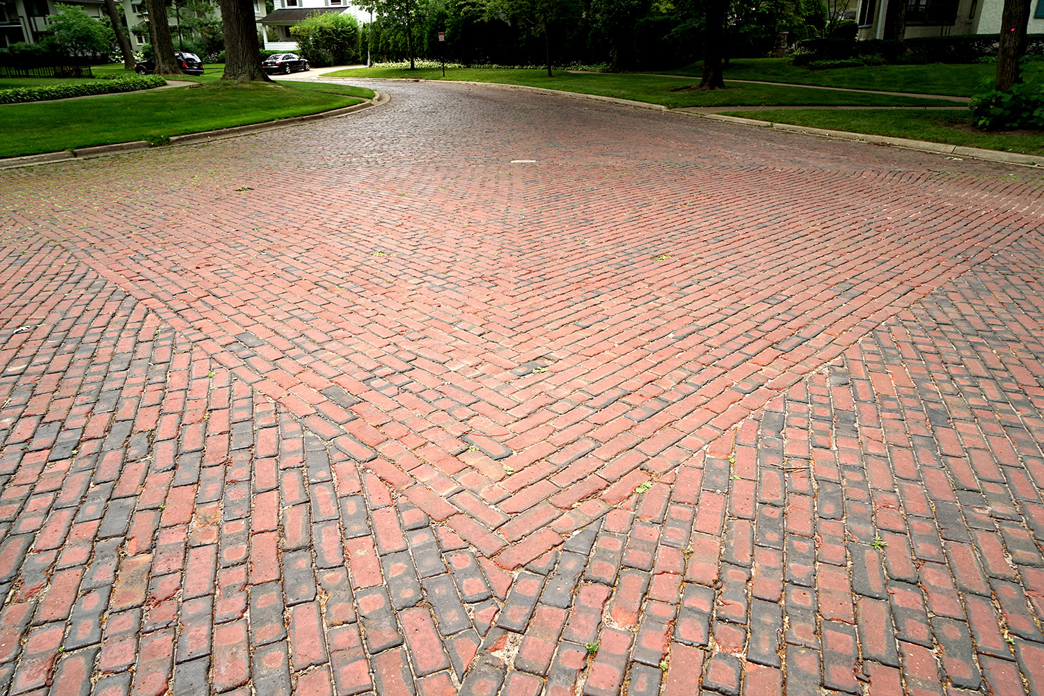 Vitrified brick pavement, intersection of Woodbine Avenue and Crescent Place, Wilmette, Illinois, 2016. Photo by author.