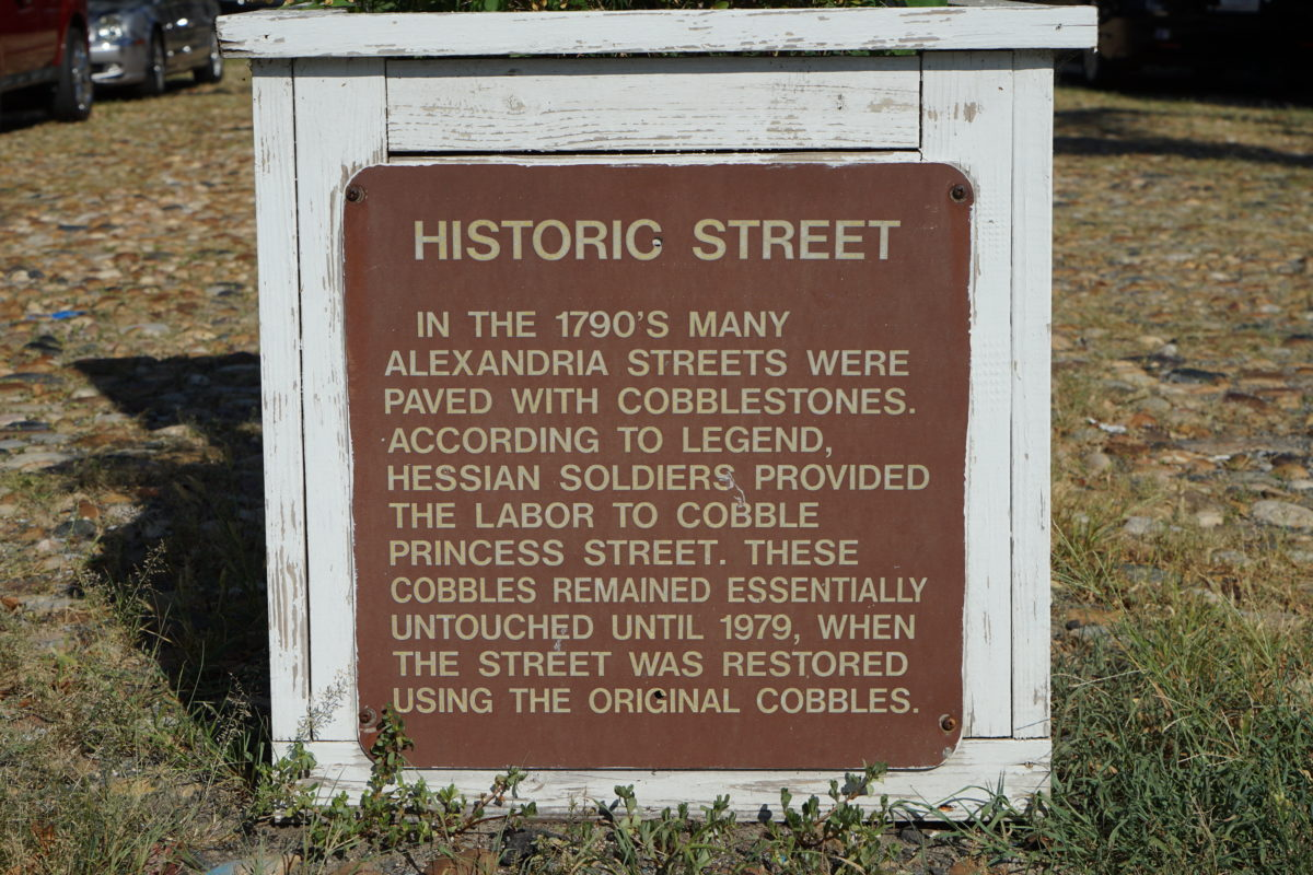 Interpretative signage about cobblestone pavement, Princess Street, Alexandria, Virginia, 2016. Photo by author.
