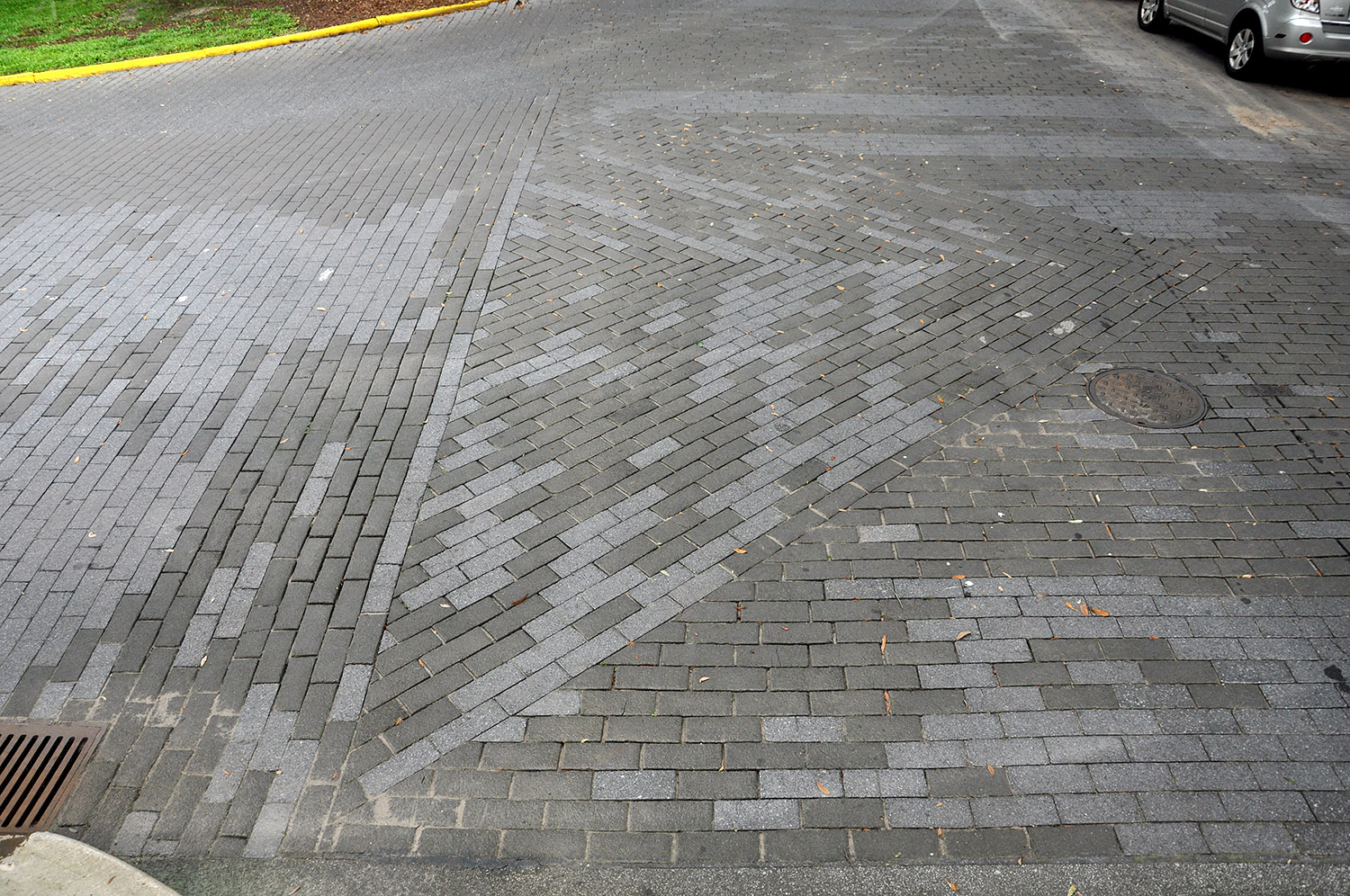 Asphalt blocks laid in a triangular formation and showing the insertion of lighter newer blocks, intersection of Barnard and West Gordon Streets, Savannah, Georgia, 2013. Photo by author.